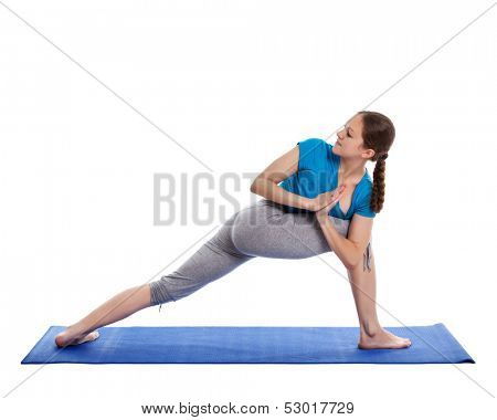 Yoga - young beautiful woman yoga instructor doing Revolved Side Angle Pose (Parivrtta Parsvakonasana) exercise isolated on white background