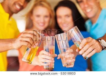 group of friends cheers with drinks