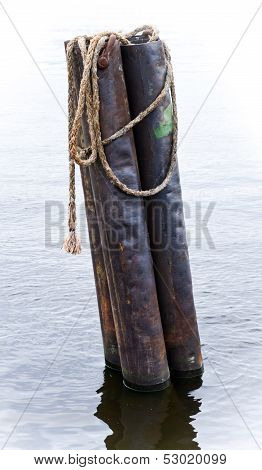 Old Rusted Mooring Post With Rope On Neva River, Saint-petersburg, Russia
