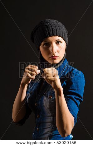 Portrait of beautiful young woman ready to fight