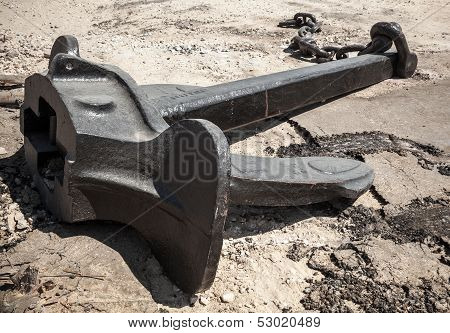Large Ship's Mooring Anchor With Broken Chain On The Ground