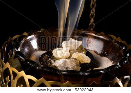 Closeup of real smoking church incense on burning charcoal