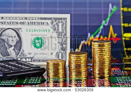 Uptrend Financial Chart,calculator,  One-dollar Banknote And Stacks Of Golden Coins . Selective Focu