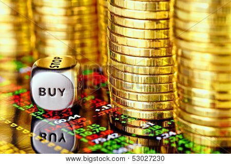 Golden Coins, Financial Chart And Dices Cube With The Word Buy. Selective Focus