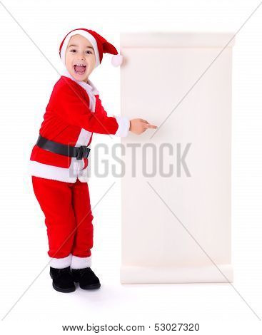 Little Santa Claus Boy Pointing At Big Wish List