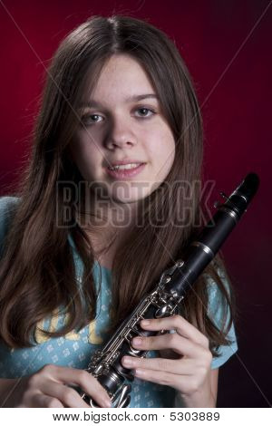 Teenage Girl Clarinet Player On Red