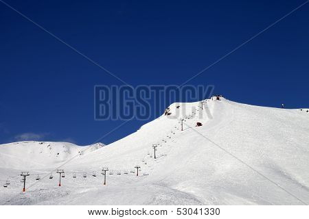 Ski Slope With Ropeway At Sun Winter Day