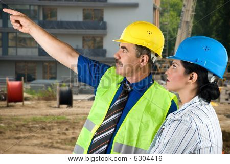 Architect Team On Site Pointing