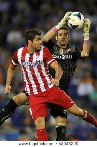 BARCELONA - OCT, 19: Diego Costa(L) of Atletico Madrid vies with Kiko Casilla(R) of Espanyol during a Spanish League match at the Estadi Cornella on October 19, 2013 in Barcelona, Spain