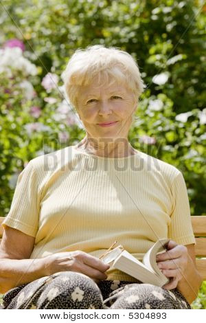 The Elderly Woman With The Book