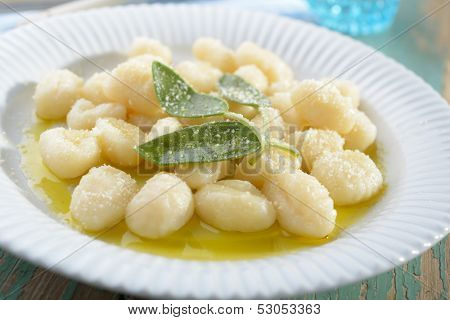Potato gnocchi dressed with olive oil, sage, and Parmesan cheese