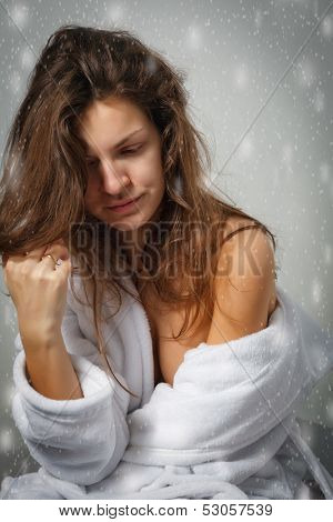 Winter depression: sad young woman