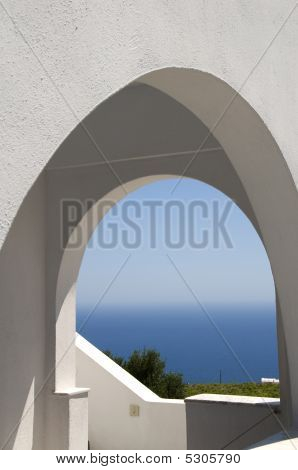 Classic Greek Island Architecture With Arches And Sea View