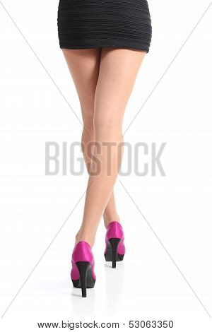 Back View Of A Woman Legs Walking With Fuchsia High Heels