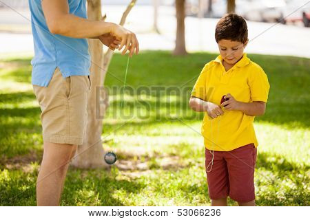 Boy and dad playing with a yo-yo
