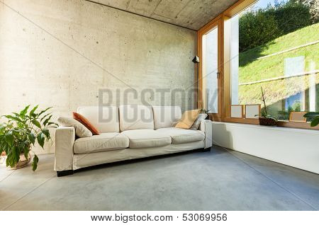 beautiful modern house in cement, interiors, room with divan