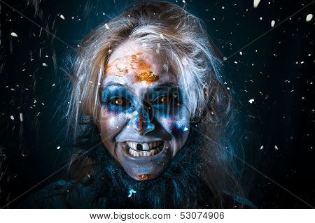 Evil Winter Monster Smiling Beneath Falling Snow