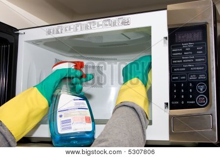 Cleaning Microwave With A Sponge