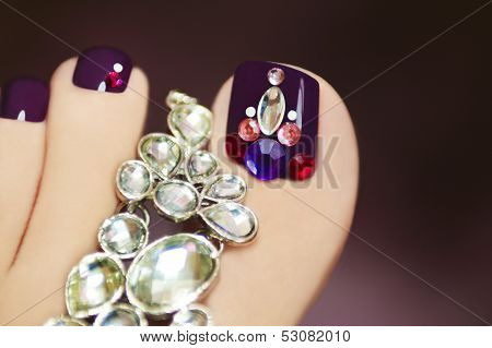 Elegant pedicure with rhinestones.