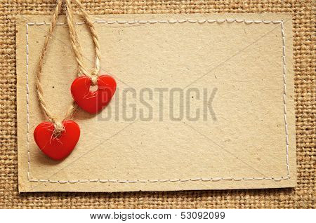 Two Hearts On A Cardboard