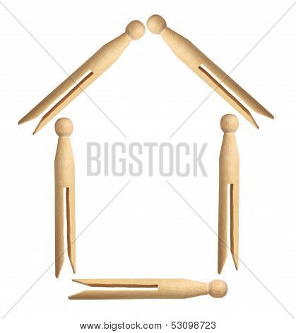 Dolly Pegs Arranged In House Shape
