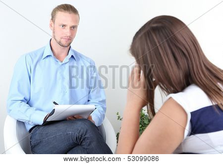 Woman with problem on reception for psychologist