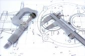 Micrometer and caliper on blueprint horizontal