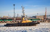 Small Tug Boat Goes Through Icy Channel In Harbor Of St.petersburg Cargo Port