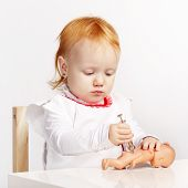 image of baby doll  - little girl playing doctor with a doll - JPG