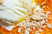 stock photo of halwa  - Sweetend mashed carrots with cream and nuts