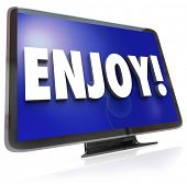 The word Enjoy on a HDTV screen to illustrate television program or show viewing in a home theatre s