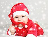 foto of santa baby  - Baby Santa Claus in snowstorm - JPG