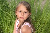 stock photo of ten years old  - A 10 year old girl looking at the camera - JPG