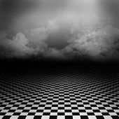 stock photo of psychedelic  - Empty, dark, psychedelic wonderland image with black and white checker on the ground and ray of light in cloudy sky