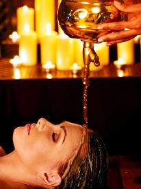 pic of panchakarma  - Young woman having oil Ayurveda spa treatment - JPG