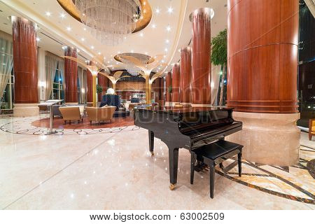 ABU DHABI, UAE - MARCH 26: Lobby and hall of Khalidiya Palace by Rotana on March 26, 2014, UAE. Rotana Hotel Management Corporation has 85 properties in 26 cities around Middle East and Africa.