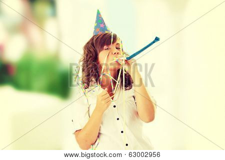 Young woman in business siut wearing party favors