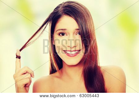 Beautiful young happy caucasian woman with healthy long hairs