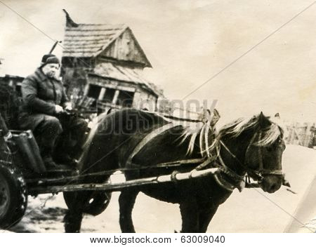 POLAND, CIRCA 1940's: Vintage photo of man on horse drawn cart