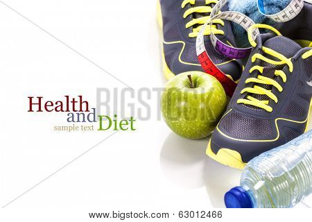 Different tools for sport and healthy food for diet on white background - sport, health and diet concept