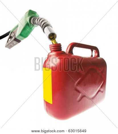 Pouring gasoline in a red jerrycan with a green nozzle on white