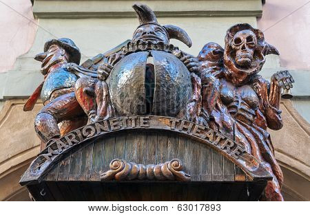 Marquee Sign For A Marionette Theatre In Prague Features Several Phantasmagoria Creatures Including