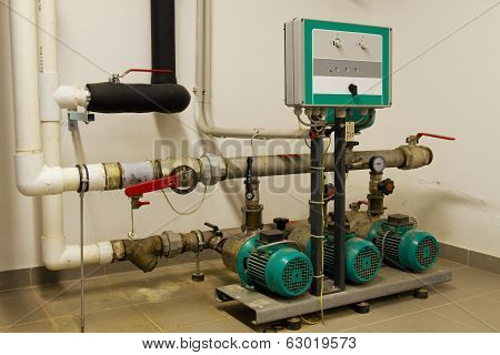 Water Pipes In The Boiler Room And Electric Motors