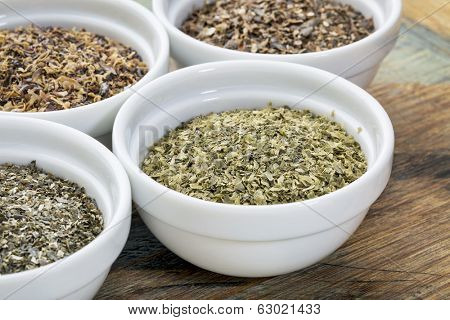 bowls of seaweed diet supplements (bladderwrack, sea lettuce, kelp, wakame and Irish moss), focus on sea lettuce