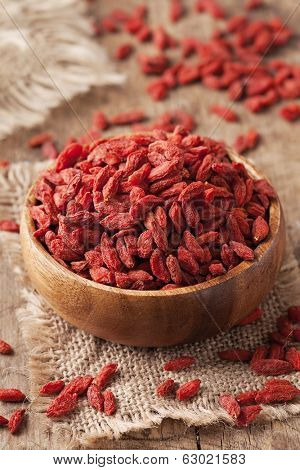Goji berries in a wooden bowl