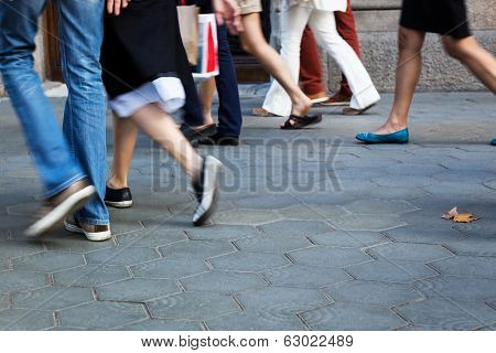 crowd of people going shopping