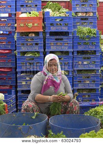 Woman Sorting Vegetables