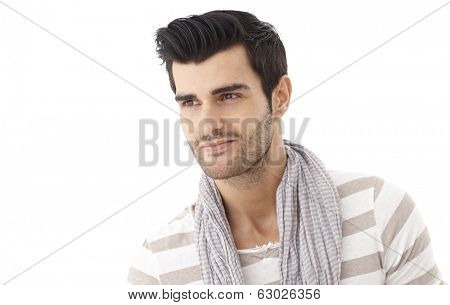 Closeup portrait of handsome young man in summertime.
