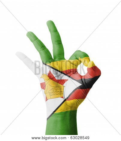 Hand Making Ok Sign, Zimbabwe Flag Painted As Symbol Of Best Quality, Positivity And Success - Isola