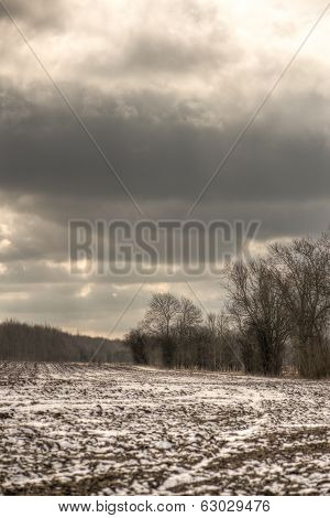 Illuminated Gloomy Clouds Over Barren Field